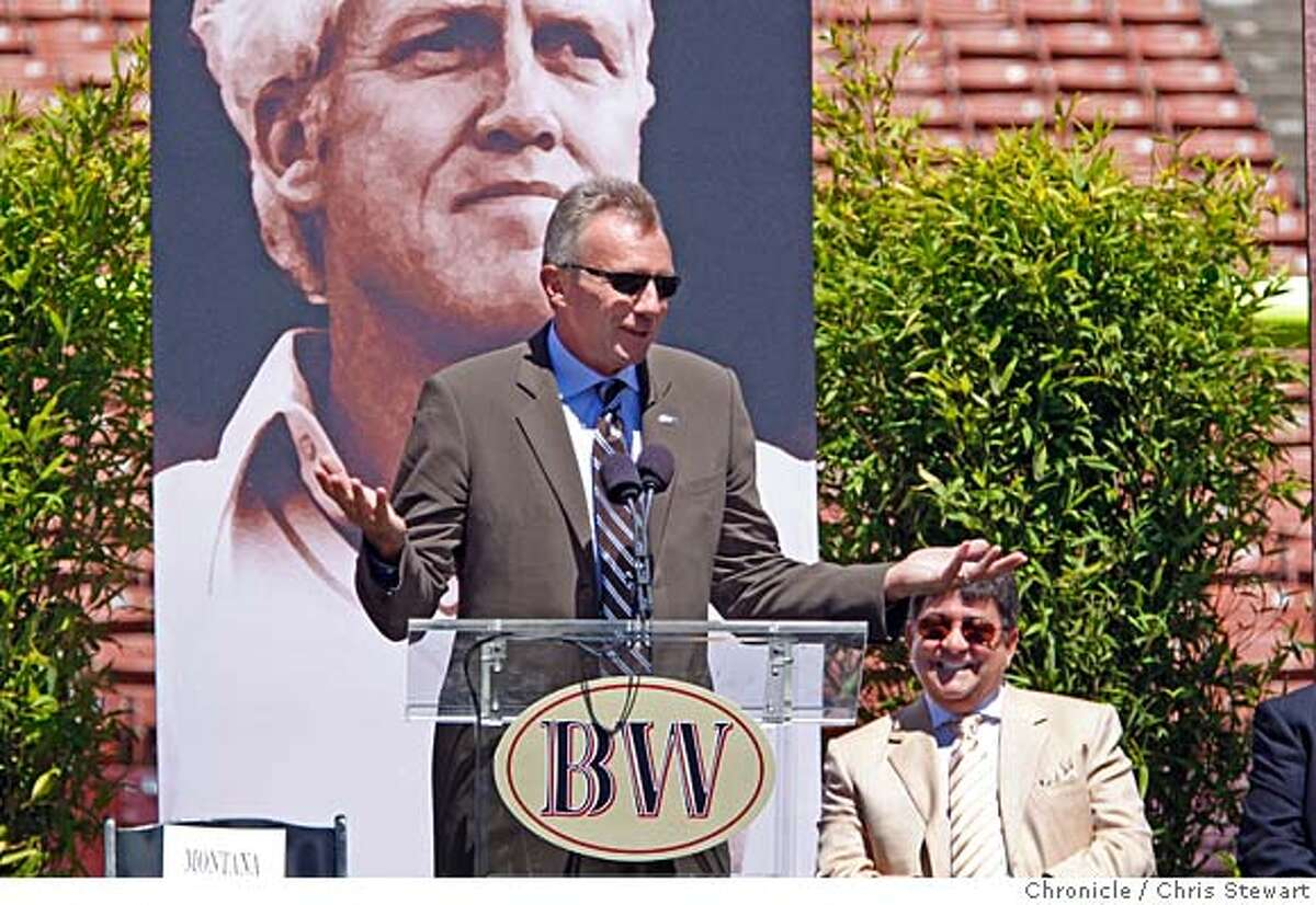 WALSH_PUBLIC_0712_cs.jpg Event on 8/10/07 in San Francisco Joe Montana recounts a story about Bill Walsh, to the amusement of former team owner Eddie DeBartolo, Jr., as thousands gathered to celebrate the life of Walsh, former head coach of the San Francisco 49ers, at Monster Park in San Francisco. Photographed August 10, 2007 Chris Stewart / The Chronicle Walsh memorial, Monster Park, Eddie DeBartolo, Jr., Joe Montana