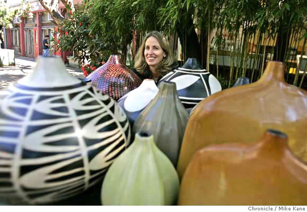 .jpg Mimi Robinson, a San Francisco artist/designer, poses with native art from Mexico and South America that she has helped to develop and market, at her studio in San Francisco, CA, on Friday, July, day}, 2007. photo taken: 7/27/07 Mike Kane / The Chronicle **Mimi Robinson MANDATORY CREDIT FOR PHOTOG AND SF CHRONICLE/NO SALES-MAGS OUT