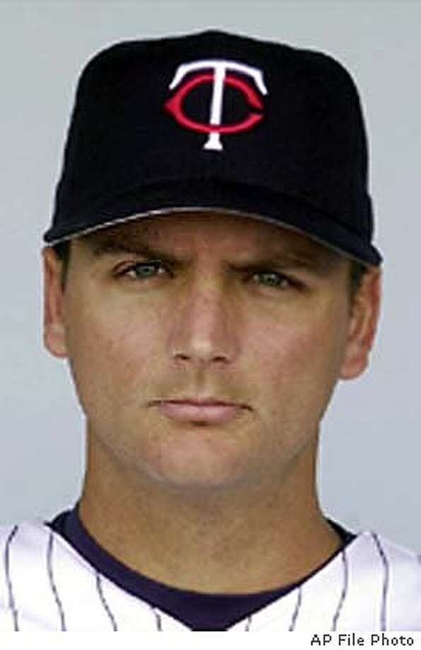 ** FILE ** Minnesota Twins catcher A.J. Pierzynski, shown in this 2002 photo, was traded Friday, Friday, Nov. 14, 2003, by the Twins to the San Francisco Giants for right-handed pitcher Joe Nathan and two minor leaguers. (AP Photo/file) Photo caption giants15_PH61015891200AP** FILE ** Minnesota Twins catcher A.J. Pierzynski, shown in this 2002 photo, was traded Friday, Friday, Nov. 14, 2003, by the Twins to the San Francisco Giants for right-handed pitcher Joe Nathan and two minor leaguers. (AP Photo-file)__A 2002 file photo Photo caption giants15_PH61015891200AP** FILE ** Minnesota Twins catcher A.J. Pierzynski, shown in this 2002 photo, was traded Friday, Friday, Nov. 14, 2003, by the Twins to the San Francisco Giants for right-handed pitcher Joe Nathan and two minor leaguers. (AP Photo-file)__A 2002 file photo A 2002 file photo