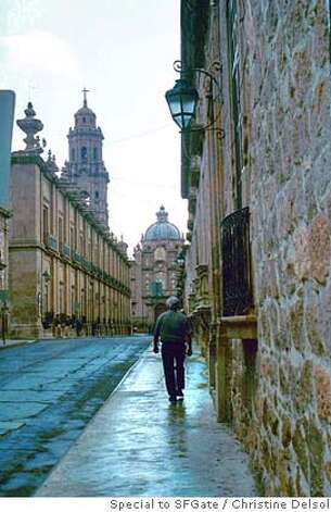 TRAVEL MEXICO -- Avenida Morelos Norte in Morelia, with Cathedral on Avenida Madera Poniente visible in the distance.  Christine Delsol /Special to SFGate Photo: Christine Delsol
