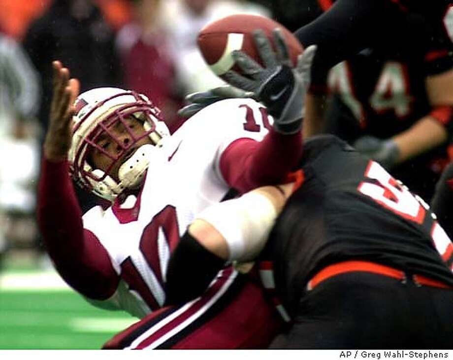 Stanford quarterback Chris Lewis (10) juggles the ball as he is sacked by Oregon State's Seth Lacey (50) during the first half Saturday, Nov. 15, 2003, in Corvallis, Ore. (AP Photo/Greg Wahl-Stephens) Chris Lewis and the Stanford offense had a rough afternoon at Oregon State last Saturday. The Cardinal managed only 133 yards. Photo: GREG WAHL-STEPHENS