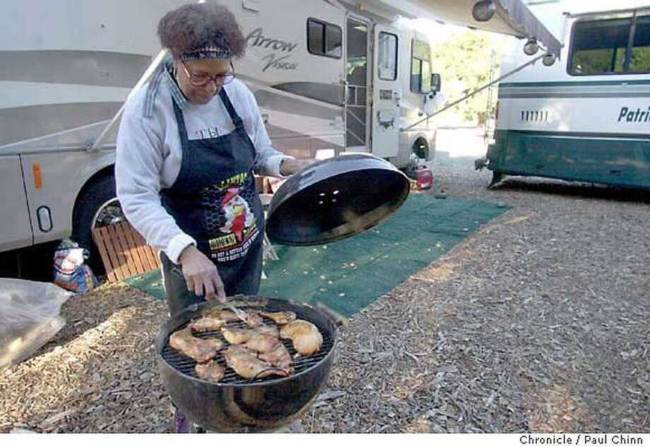 biggame079_pc.jpg Tais Hawkins barbecues chicken at her campground in front of Stanford Stadium. Hawkins and her husband beat the traffic by arriving Thursday afternoon driving their motor home up from San Jose. Final preparations for the annual Big Game in Stanford on 11/21/03. PAUL CHINN / The Chronicle MANDATORY CREDIT FOR PHOTOG AND SF CHRONICLE/ -MAGS OUT Photo: PAUL CHINN