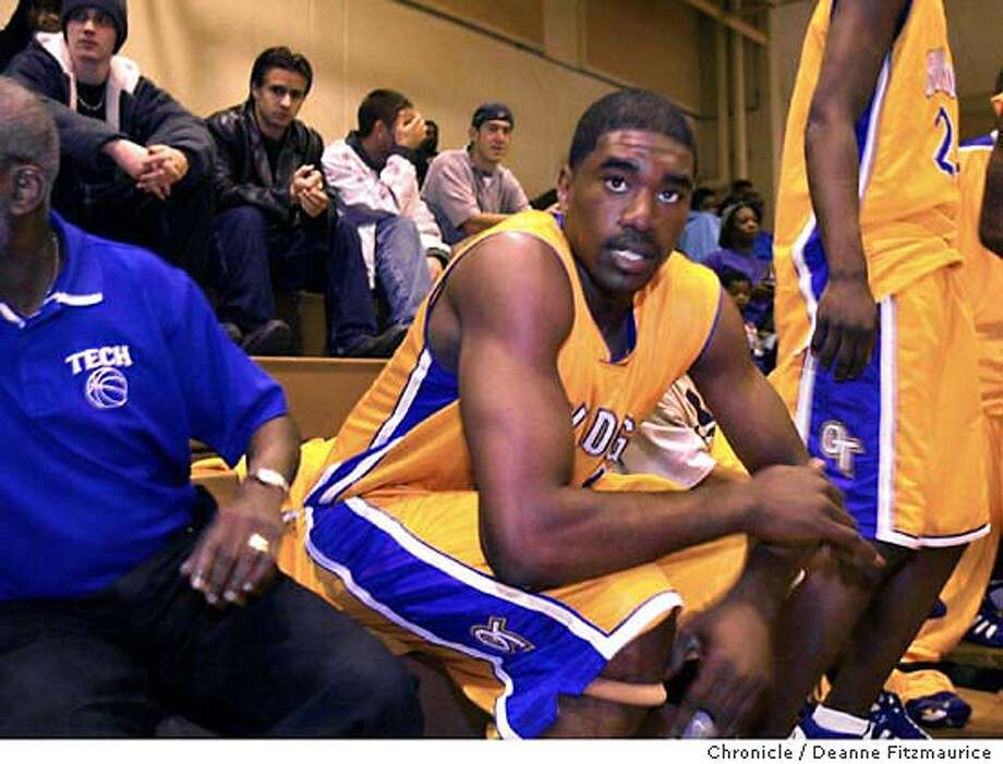 EBPOWE06A-C-23NOV02-EF-DF  Leon Powe (#44), Oakland Technical High School on bench before game against Balboa at Oakland Tech in Oakland.  CHRONICLE PHOTO BY DEANNE FITZMAURICE Photo: DEANNE FITZMAURICE