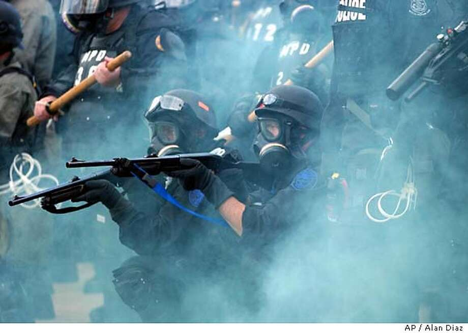 Miami riot police fire on protesters during a Free Trade Area of the Americas protest after demonstrators became unruly Thursday, Nov. 20, 2003, in downtown Miami. (AP Photo/Alan Diaz) Miami riot police fire on protesters outside a Free Trade Area of the Americas meeting. Authorities made dozens of arrests. Photo: ALAN DIAZ