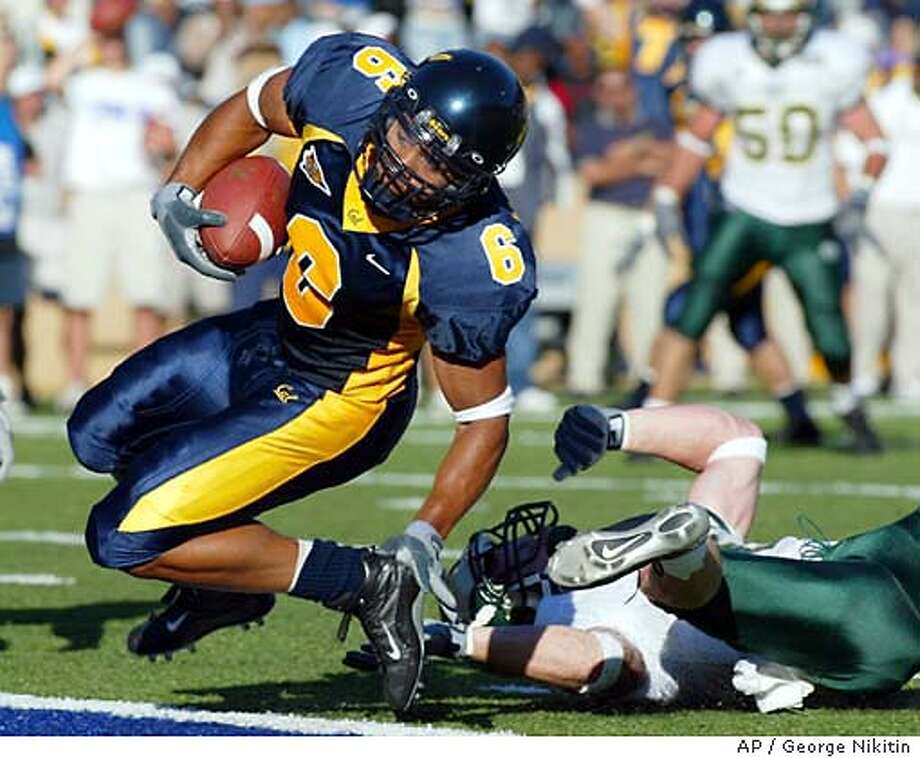 California's Geoff McArthur scores a touchdown in the fourth quarter against Colorado State, Saturday, Sept. 6, 2003, in Berkeley, Calif. Colorado State won 23-21. (AP Photo/George Nikitin) CAT Photo: GEORGE NIKITIN