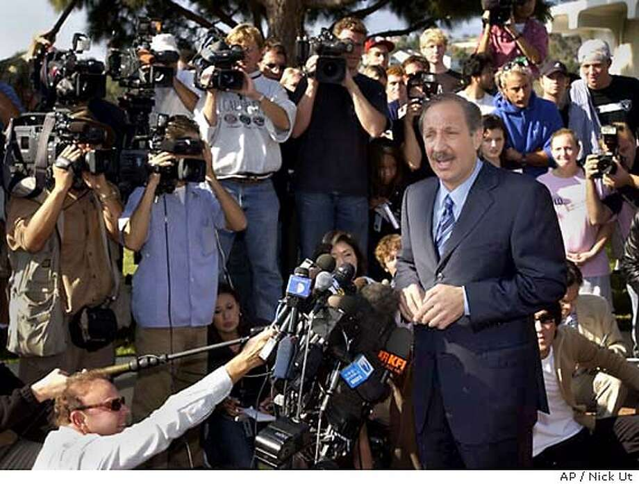 Attorney Mark Geragos speaks to the media after his client, Michael Jackson, was booked on child molestation charges at the Santa Barbara County Jail facility Thursday, Nov. 20, 2003. (AP Photo/Nick Ut) Photo: NICK UT
