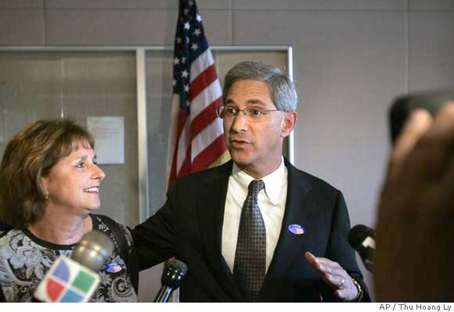 Steve Poizner, candidate for California State Insurance Commissioner, is flanked by his wife, Carol, as he talks to reporters after casting his absentee ballot at the Santa Clara County Registrar of Voters, in San Jose, Calif., Tuesday, Nov., 7, 2006. (AP Photo/Mercury News, Thu Hoang Ly)  Ran on: 11-08-2006  Steve Poizner, the Republican candidate for state insurance commissioner, with his wife, Carol, beside him, talks to reporters after casting his absentee ballot in San Jose.  Ran on: 11-08-2006 Ran on: 11-08-2006  Steve Poizner, the Republican candidate for state insurance commissioner, with his wife, Carol, beside him, talks to reporters after casting his absentee ballot in San Jose.  Ran on: 11-08-2006 ALSO Ran on: 05-24-2007  Steve Poizner wants Allstate to show that its insurance rates in California are not excessive. MAGS OUT NO SALES Photo: THU HOANG LY