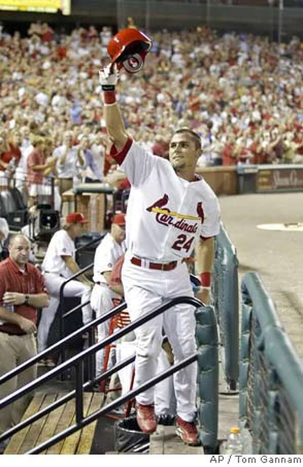 St. Louis Cardinals' Rick Ankiel takes a curtain call for the fans after hitting a three-run home run in the seventh inning against the San Diego Padres in their baseball game Thursday, Aug. 9, 2007, in St. Louis.(AP Photo/Tom Gannam) EFE OUT Photo: Tom Gannam