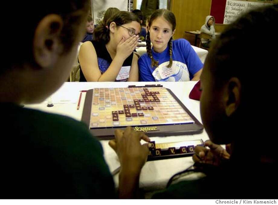 SCRABBLE05a-C-04MAY02-MT-KK  Sarah Zollner, 11, (Left) whispers tactics to partner Kristi Myllenbeck, 10, during the School Scrabble Championships at Oakland's Fruitvale Elementary School Saturday. The girls are from Jackson Avenue School. In the foreground L to R are their opponents, Heather Souza, 10, and Danielle Knowell, 11, from St. Jarlath. CAT Photo: KIM KOMENICH