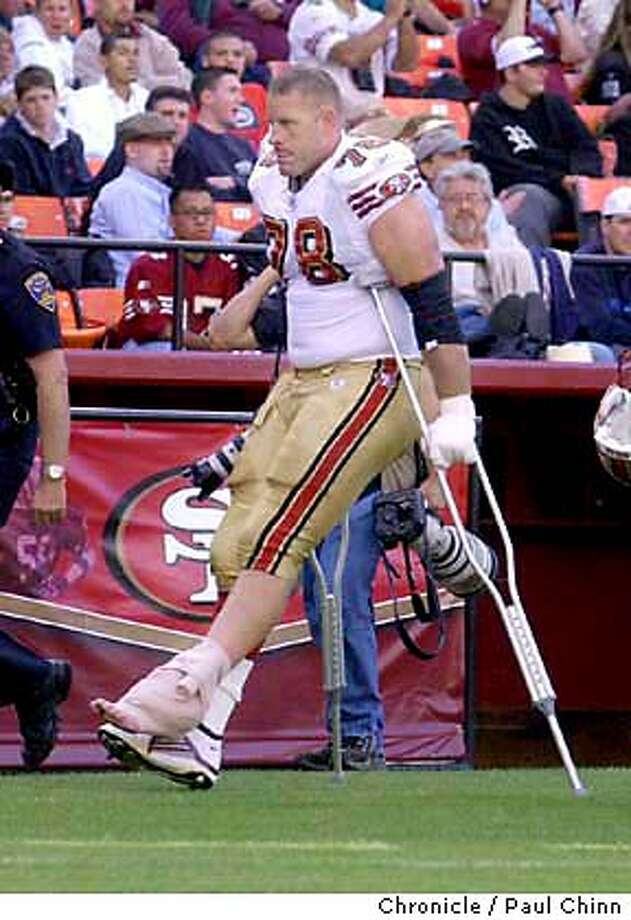 raiders238_pc.jpg 49ers tackle Scott Gragg left the game on crutches. Pre-season game between the Oakland Raiders and San Francisco 49ers in San Francisco on 8/14/03. First half action. PAUL CHINN / The Chronicle MANDATORY CREDIT FOR PHOTOG AND SF CHRONICLE/ -MAGS OUT Photo: PAUL CHINN