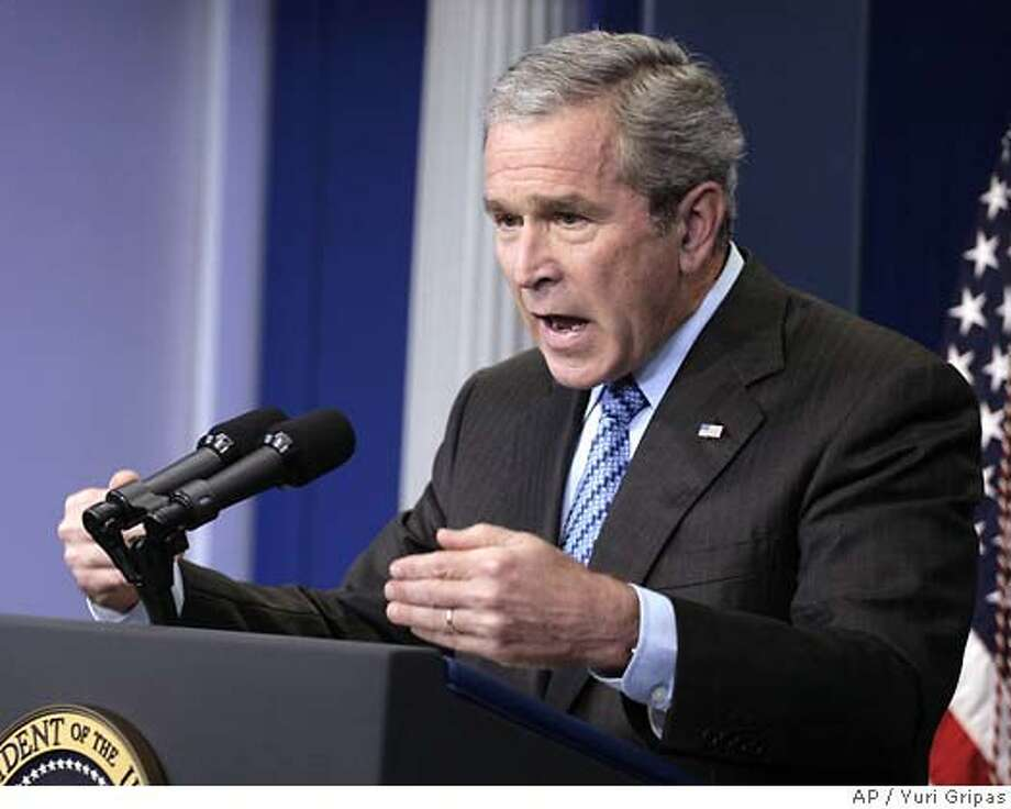 U.S. President George W. Bush speaks during a news conference in the White House press room in Washington before departing for the start of his summer vacation August 9, 2007. REUTERS/Yuri Gripas (UNITED STATES) 0 Photo: YURI GRIPAS