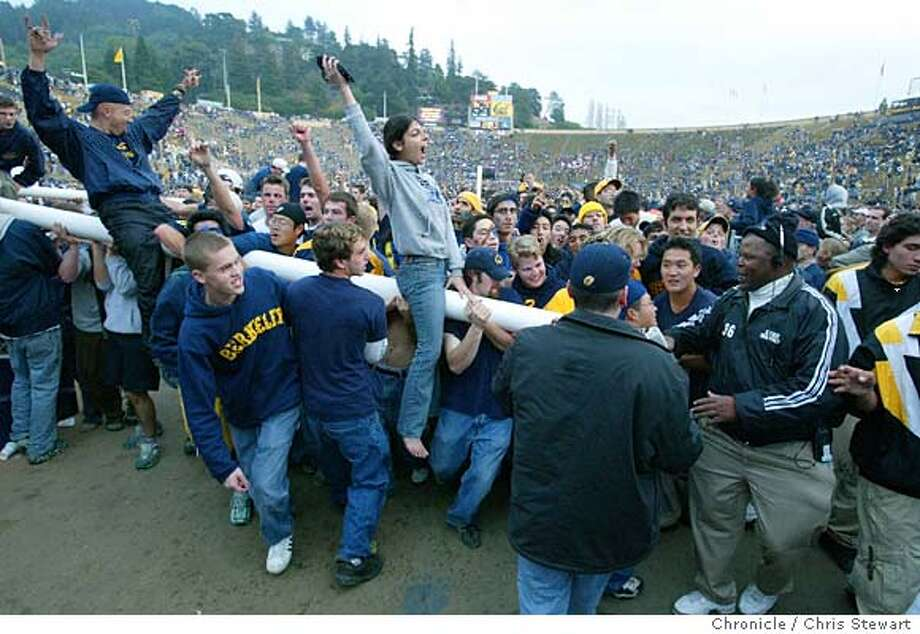 BIG01-C-23NOV02-SP-CS Cal fans exult after breaking down the goal posts following their victory over the Stanford Cardinals in the Big Game at Memorial Stadium on the Cal campus. BY CHRIS STEWART/THE CHRONICLE Photo: CHRIS STEWART