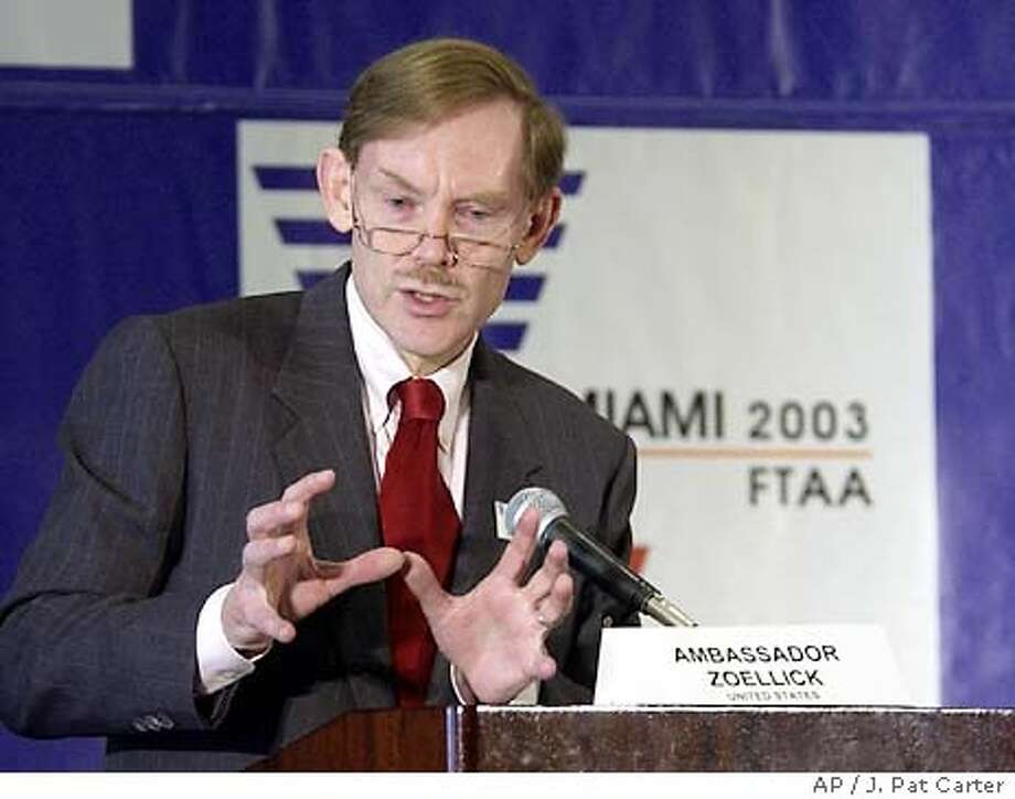 U.S. Trade Repesentative Robert Zoellick makes his case for a free trade agreement at the FTAA meetings in Miami, Wednesday, Nov. 19, 2003. The meeting approved a draft Wednesday of the world's largest free trade region, adopting a version that allows countries to opt out of some requirements, officials from the Brazilian delegation said. (AP Photo/J. Pat Carter) Photo: J. PAT CARTER