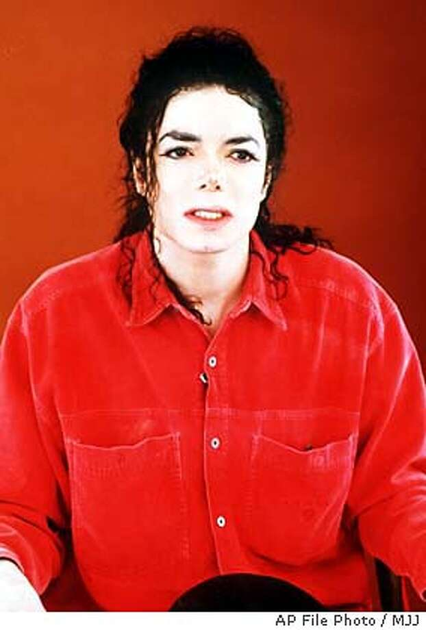 **FILE** Superstar speaks during a televised statement broadcast live from his Neverland ranch near Los Olivos, California, in a December 22, 1993 file photo, proclaiming his innocence in light of child molestation accusations against him. Jackson ended up settling out of court and the case never went to trial. Authorities in Santa Barbara, Calif., issued an arrest warrant for on multiple counts of molesting a child and asked the pop superstar to turn in his passport and surrender, law enforcement officials said Wednesday, Nov. 19, 2003. (AP Photo/MJJ) Photo: MJJ