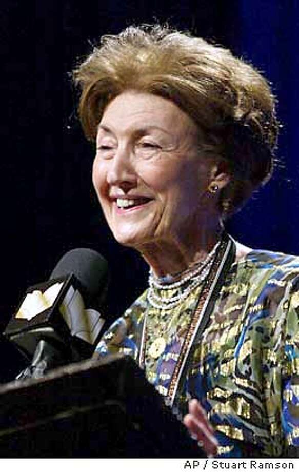 """Shirley Hazzard makes her acceptance speech after winning the Fiction category at the 2003 National Book Awards in New York City, with her book titled """"The Great Fire"""", Wednesday, Nov. 19, 2003. (AP Photo/Stuart Ramson) Photo: STUART RAMSON"""