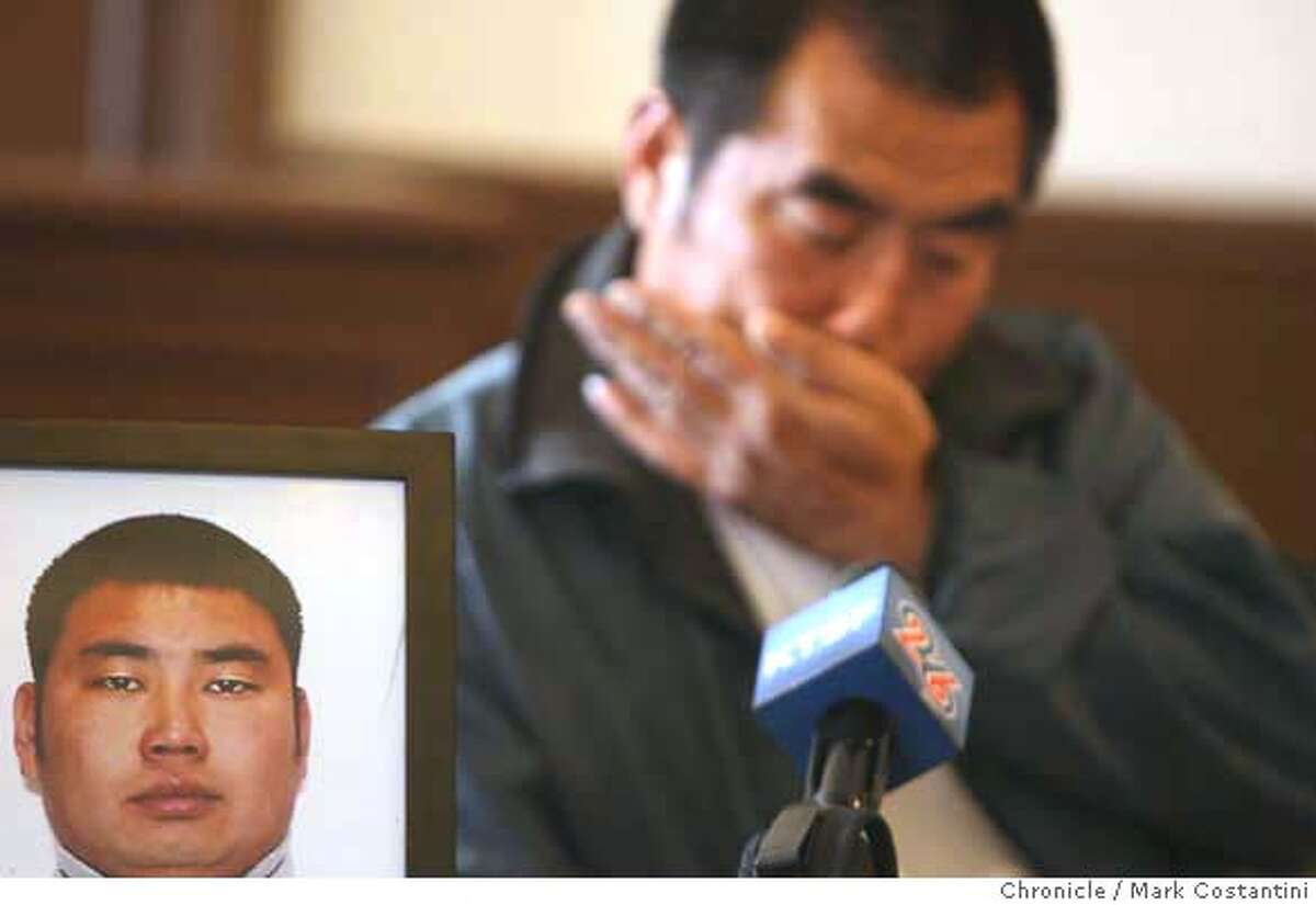 Huiquan Chang, 48, El Cerrito, weeps as he speaks about his son Jinzhou Chang(in the photo beside him), who was murdered as they were both working at an apartment building on Belmont St. in El Cerrito. Photo: Mark Costantini / S.F. Chronicle Ran on: 08-01-2007 Huiquan Chang weeps for his son, Jinzhou Chang, (in photo), who was shot and killed.