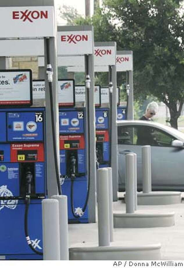 An Exxon station is shown in Keller, Texas, Wednesday, July 25, 2007. Exxon Mobil Corp., the world's largest publicly traded oil company, said Thursday, July 26, 2007 its second-quarter profit fell 1 percent from a year ago as lower natural gas prices hurt results. (AP Photo/Donna McWilliam) Photo: Donna McWilliam