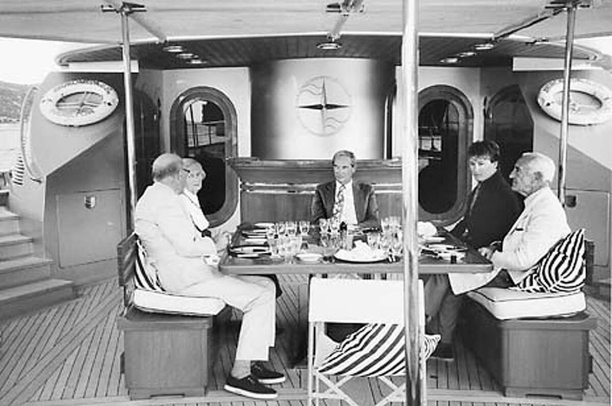 for O'Brian20 ; Patrick O'Brian and guests join Tom Perkins for a meal below decks. , / HO