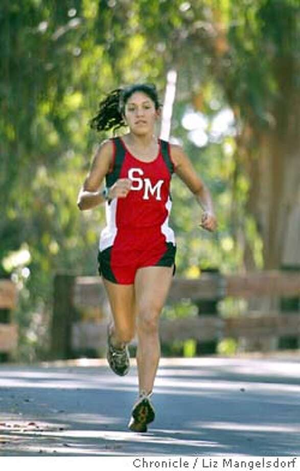 46FB0084.JPG  Runner Gabi Rios-Sotelo, a cross country runner for St. Mary's High School track team in Berkeley. She finished second in the North coast Section Division IV race last year as a sophomore, and is a favorite to win it this year. Event on 9/11/03 in Berkeley. LIZ MANGELSDORF / The Chronicle Photo: LIZ MANGELSDORF