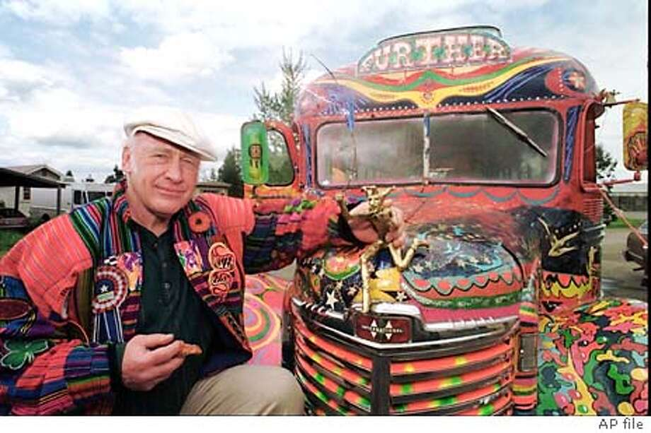 "** FILE **Author Ken Kesey poses in this April 24, 1997, file photo in Springfield, Ore., with his bus, ""Further"", a descendant of the vehicle that carried him and the Merry Pranksters on the 1964 trip immortalized in the Tom Wolfe book, ""The Electric Kool-Aid Acid Test."" A life-sized bronze statue of the late author sitting on a bench reading to three children will be unveiled in Eugene, Ore., Friday, Nov. 14, 2003. (AP Photo/Jeff Barnard,) Photo: JEFF BARNARD"