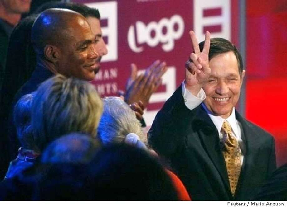Democratic presidential hopeful Dennis Kucinich (R) gestures toward the audience as he is introduced at the Visible Vote '08 Presidential Forum sponsored by the Human Rights Campaign Foundation and broadcast on the Logo Network in Hollywood August 9, 2007. REUTERS/Mario Anzuoni (UNITED STATES) 0 Photo: MARIO ANZUONI