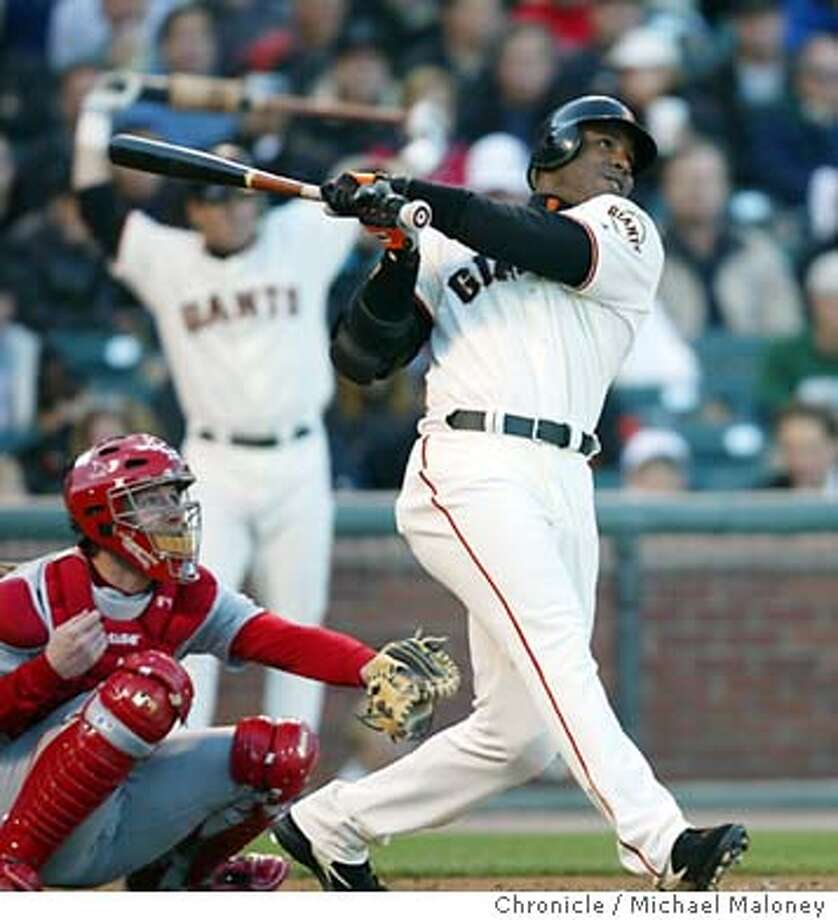 Barry Bonds watches his 1st inning solo homer go out of the park. St Louis catcher : Chris Widger.  SF Giants vs St Louis Cardinals, opening a two game series at Pac Bell Park in San Francisco.  Event on 7/7/03 in San Francisco.  MICHAEL MALONEY / The Chronicle Photo: MICHAEL MALONEY