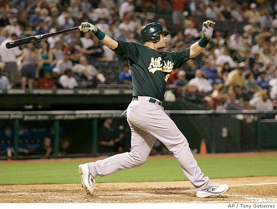 Oakland Athletics' Rob Bowen follows through on a two-run home run off of Texas Rangers pitcher Wes Littleton that scored Donnie Murphy in the eighth inning of a baseball game in Arlington, Texas, Wednesday, Aug. 8, 2007. The shot was Bowen's second home run of the night. (AP Photo/Tony Gutierrez) Photo: Tony Gutierrez