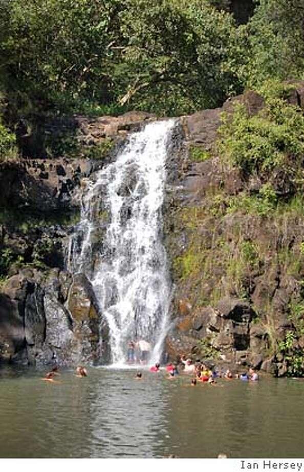 Travel Hawaii Waimea Falls -- Waimea Falls in the Waimea Valley Audubon Center on Oahu's North Shore is an easy place to experience a dip in a waterfall pool. For Aloha Friday 8/10 Photo: Ian Hersey
