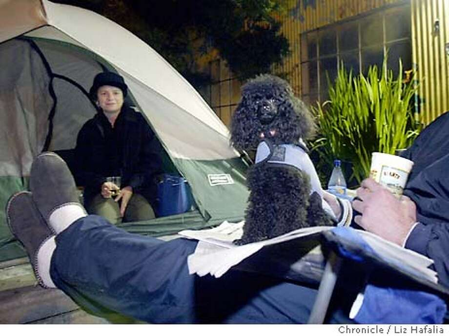 Every year, art fans camp out for several nights in order to get good places in line at the annual Visual AID art sale. Elizabeth Palmer (left) and Steve Hoza (legs) and Sailor (dog) are #5 in line. Shot on 11/14/03 in San Francisco. LIZ HAFALIA / The Chronicle Photo: LIZ HAFALIA
