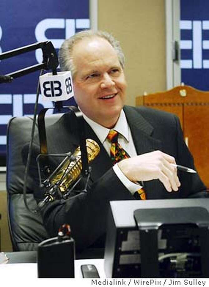Talk radio host Rush Limbaugh prepares for his first daily radio show since he entered a rehabilitation program for an addiction to painkillers, in his New York studio on Monday, November 17, 2003. (AP Photo/Medialink / WirePix / Jim Sulley) Photo: JIM SULLEY