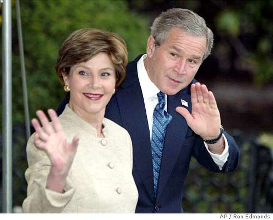 President Bush and first lady Laura Bush depart the White House Tuesday, Nov. 18, 2003, for a trip to the United Kingdom. Bush is joining with America's staunchest ally in the war in Iraq for a state visit that promises contrasting pictures of elegant ceremonies at Buckingham Palace and noisy street protests by thousands of anti-war demonstrators. (AP Photo/Ron Edmonds) Photo: RON EDMONDS