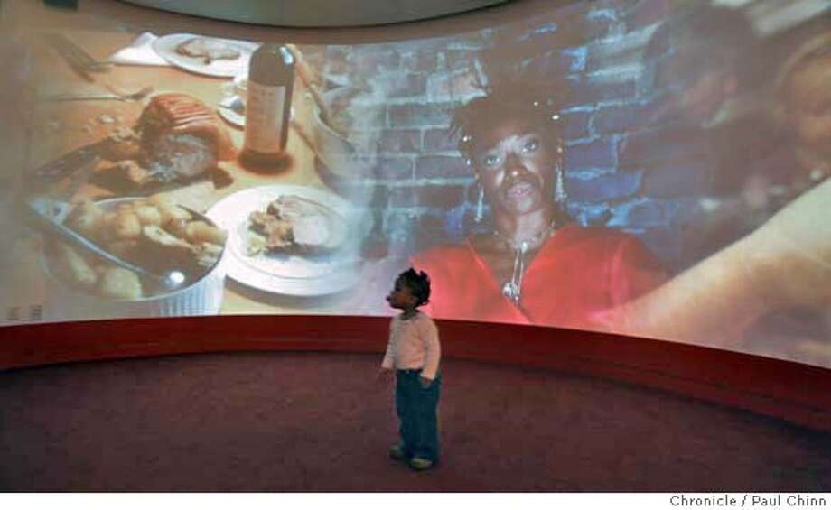 diaspora04_026_pc.jpg  One-year-old Janice Demings experiences a multimedia presentation in the Celebration Circle theater in the Museum of the African Diaspora in San Francisco, Calif. on 12/3/05.  PAUL CHINN/The Chronicle MANDATORY CREDIT FOR PHOTOG AND S.F. CHRONICLE/NO SALES - MAGS OUT Photo: PAUL CHINN
