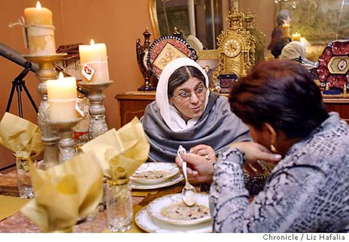 Afifa Azim is the founder of the Afghan Women's Network. She is in the bay area for a three-day visit . She is talking to Fanzia Ahamed, of Fremont, while they are eating ash. Shot on 11/15/03 in Union City. LIZ HAFALIA / The Chronicle