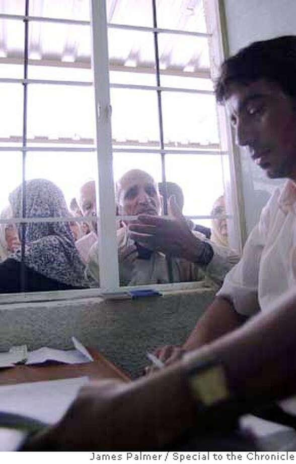 A clerk prepares to issue passports at the central travel office in Baghdad, Iraq, on June 20, 2007. The UNHCR estimates that 2.2 million Iraqis have already fled their homeland and are living abroad as refugees � 790,000 in the last year alone according to a recent report by the U.S. Committee for Refugees and Immigrants. As Iraqis continue to emigrate in droves from their homeland, officials in the country�s central travel office say they are besieged with up to 3,000 passport applications every week. JAMES PALMER / FOR THE CHRONICLE Photo: JAMES PALMER / FOR THE CHRONICLE