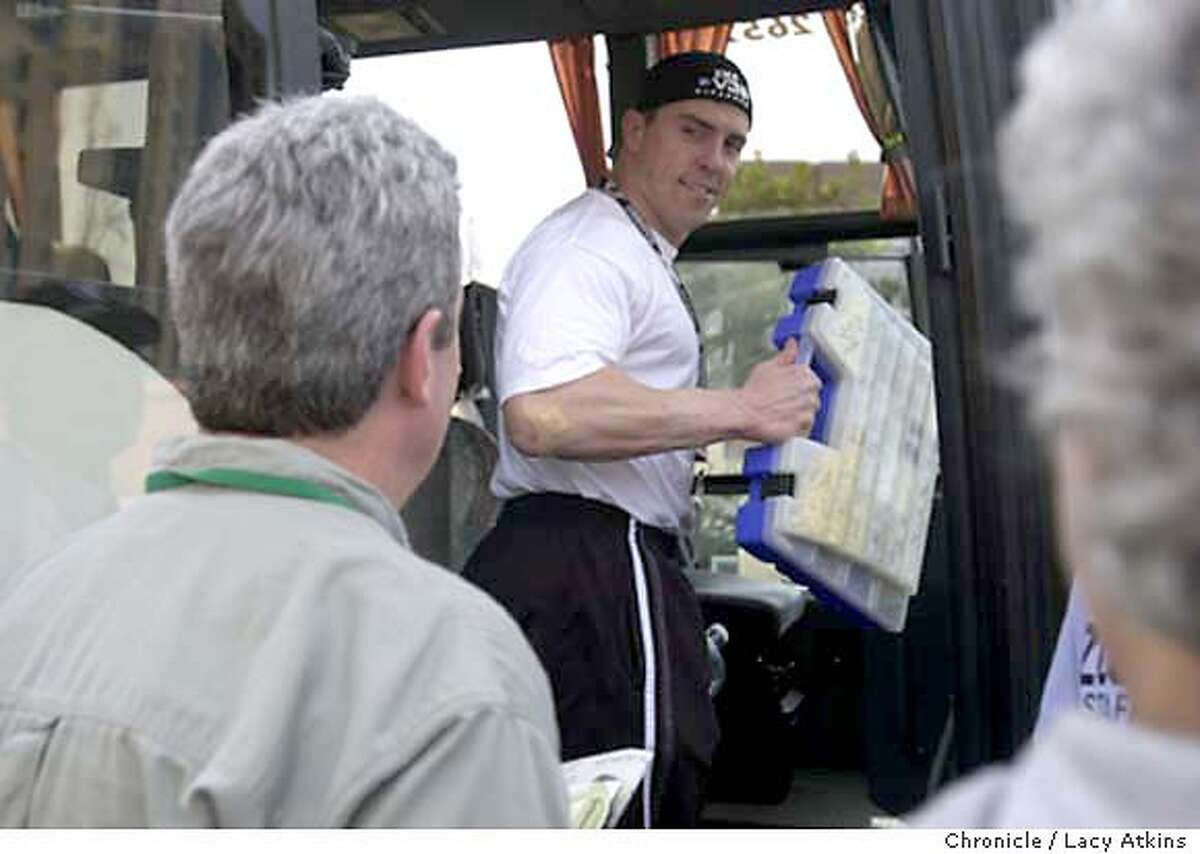 WEDRAIDSD10-C-22JAN03-SP-LA Raiders Bill Romanowski gives away from the media as he boards the team bus for practice with his case of meds and vitamins, at the hotel in LaJolla, Wed. Jan22,03. SAN FRANCISCO CHRONICLE/LACY ATKINS CAT