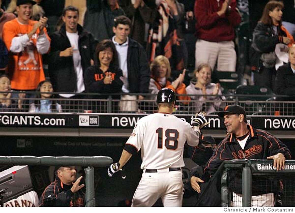 Giants Matt Cain is gets high fives after hitting a home run in the 5th inning. Giants v. Nationals at ATT Park. Photo: Mark Costantini / S.F. Chronicle