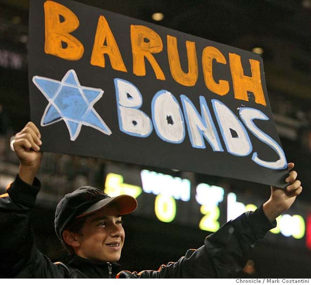 Giants fan Eli Feldman, 13, Palo Alto with a sign that is Barry Bond's name in Hebrew. It was Jewish Heritage Night tonight at AT$T Park. Giants v. Nationals at ATT Park. Photo: Mark Costantini / S.F. Chronicle