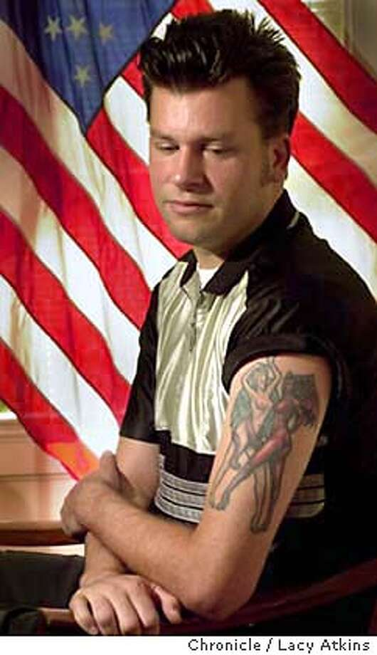 George Lazaneo, who says he was strip-searched at the sf jail and then photographed naked by a female jail employee who said the pictures were of his tatoos for a national databank. Portrait was shot in his attorneys office in San Francisco, Sept. 22, 2003.9/22/03 in San Francisco. / The Chronicle Photo: Atkins, Lacy