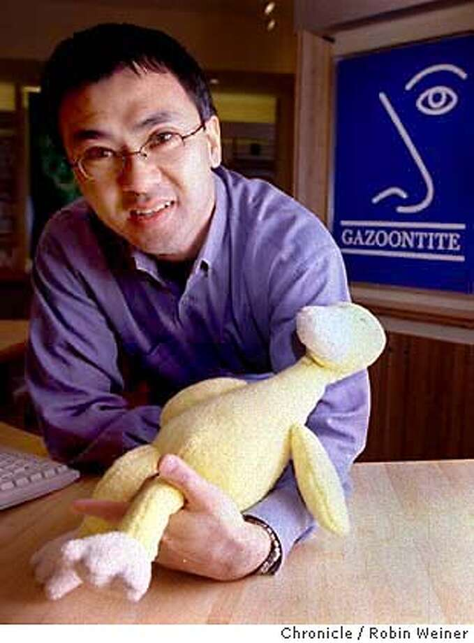 GAZOONTITE3/C/30MAR99/BU/RW Soon-Chart Yu, CEO of Gazoontite, holds Giligan, the store's signature duck. Gazoontite specializes in allergy products.  BY ROBIN WEINER/THE CHRONICLE Photo: ROBIN WEINER