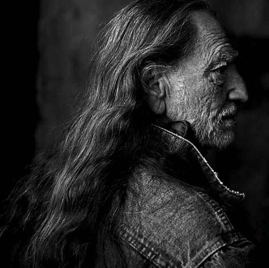 """TRAVEL SEATTLE, Wash. -- Willie Nelson, Luck Ranch, Spicewood, Texas, 2001. From the """"American Music"""" exhibit, a collection of Annie Leibovitz's portraits, sponsored by Getty Images. On display at Experience Music Project Nov. 8,2003-Jan. 19, 2004.  copyright 2001 by Annie Leibovitz, courtesy Experience Music Project. Photo: Annie Leibovitz"""