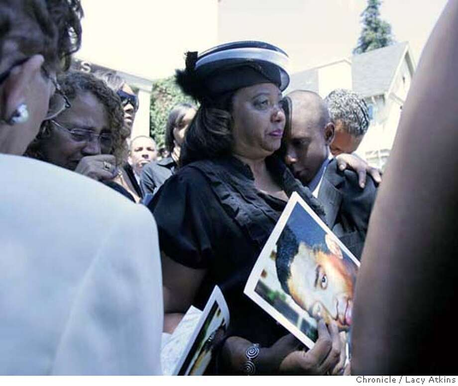 Chauncy Bailey III, right is held by his mother ( no one could tell me her name) as they follow the casket out of the St. Benedict's Catholic Church for the funeral service of Oakland Post Editor Chauncy Bailey, Wed. Aug. 8, 2007, in Oakland, Ca. (Lacy Atkins /San Francisco Chronicle) MANDATORY CREDITFOR PHOTGRAPHER AND SAN FRANCISCO CHRONICLE/NO SALES-MAGS OUT Photo: Lacy Atkins