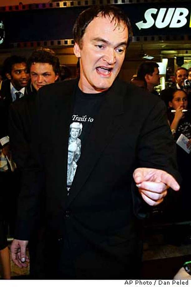 "Director Quentin Tarantino gestures to a journalist at the Australian premier of his movie ""Kill Bill"" in Sydney, Wednesday, Oct. 15, 2003. (AP Photo / Dan Peled) Photo: DAN PELED"