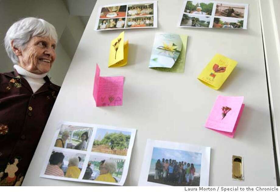 PEACECORPS08_0108_LKM.JPG 81-year-old Margaret Pratley keeps mementos from her Peace Corps trip to Thailand on the wall of her Berkeley apartment. Pratley returned in March after two years in Thailand, which was her third stint in the Peace Corps. She also worked with the corps in Sri Lanka and Lesotho. (Laura Morton/Special to the Chronicle) *** Margaret Pratley Photo: Laura Morton