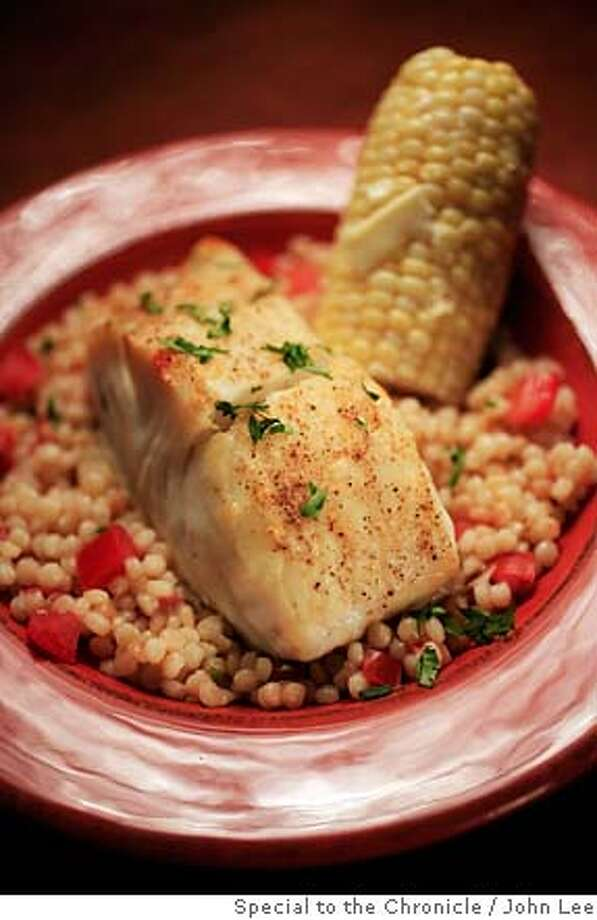 WORKING01_JOHNLEE.JPG  Broiled fish with Israeli couscous pilaf and corn.  By JOHN LEE/SPECIAL TO THE CHRONICLE Photo: John Lee
