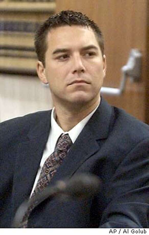** FILE ** Scott Peterson, who is accused of murdering his wife, Laci and the couple's unborn son, sits in court in this Sept. 2, 2003 file photo, in Modesto, Calif. A preliminary hearing to determine whether there is enough evidence to try Peterson on murder charges starts Wednesday, Oct. 29, 2003. (AP Photo/The Modesto Bee, Al Golub, File) POOL PHOTO, SEPT. 2, 2003 FILE PHOTO Scott Peterson is charged with murder in the deaths of his wife and their unborn son. Police believe Scott Peterson killed his pregnant wife, Laci, at their Modesto home on Dec. 23 or 24. Police believe Scott Peterson killed his pregnant wife, Laci, at their Modesto home on Dec. 23 or 24. Police believe Scott Peterson killed his pregnant wife, Laci, at their Modesto home on Dec. 23 or 24. Scott Peterson visited the marina when divers were reportedly searching the bay. Scott Peterson visited the marina when divers were reportedly searching the bay. ##Chronicle#10/30/2003####0421460936 Photo: AL GOLUB