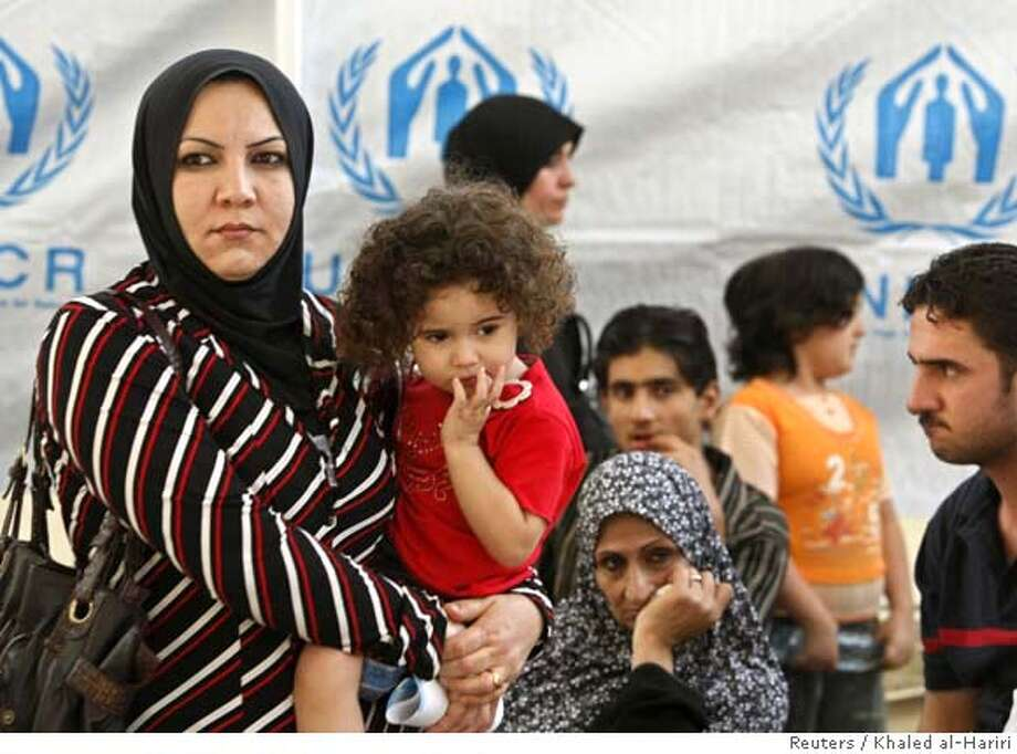 Iraqi refugees wait to register their names at the U.N. Higher Commissioner for Refugees (UNHCR) centre in the Douma suburb of Damascus July 19, 2007. Syria hosts more than one million Iraqi refugees who fled their homeland after the 2003 U.S.-led invasion of Iraq. REUTERS/Khaled al-Hariri (SYRIA) 0 Photo: KHALED AL-HARIRI