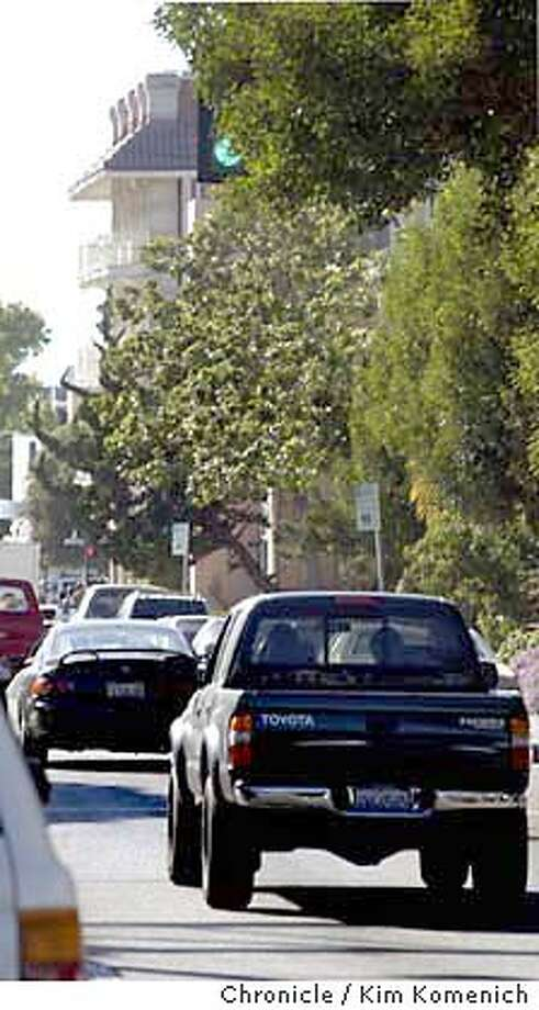 10/12/03 in Berkeley.  Chronwatch features Haste Street in Berkeley, heading westbound at the corner of Fulton, where the trees on the right side of the street have obscured the traffic signals.  KIM KOMENICH / The Chronicle Photo: KIM KOMENICH