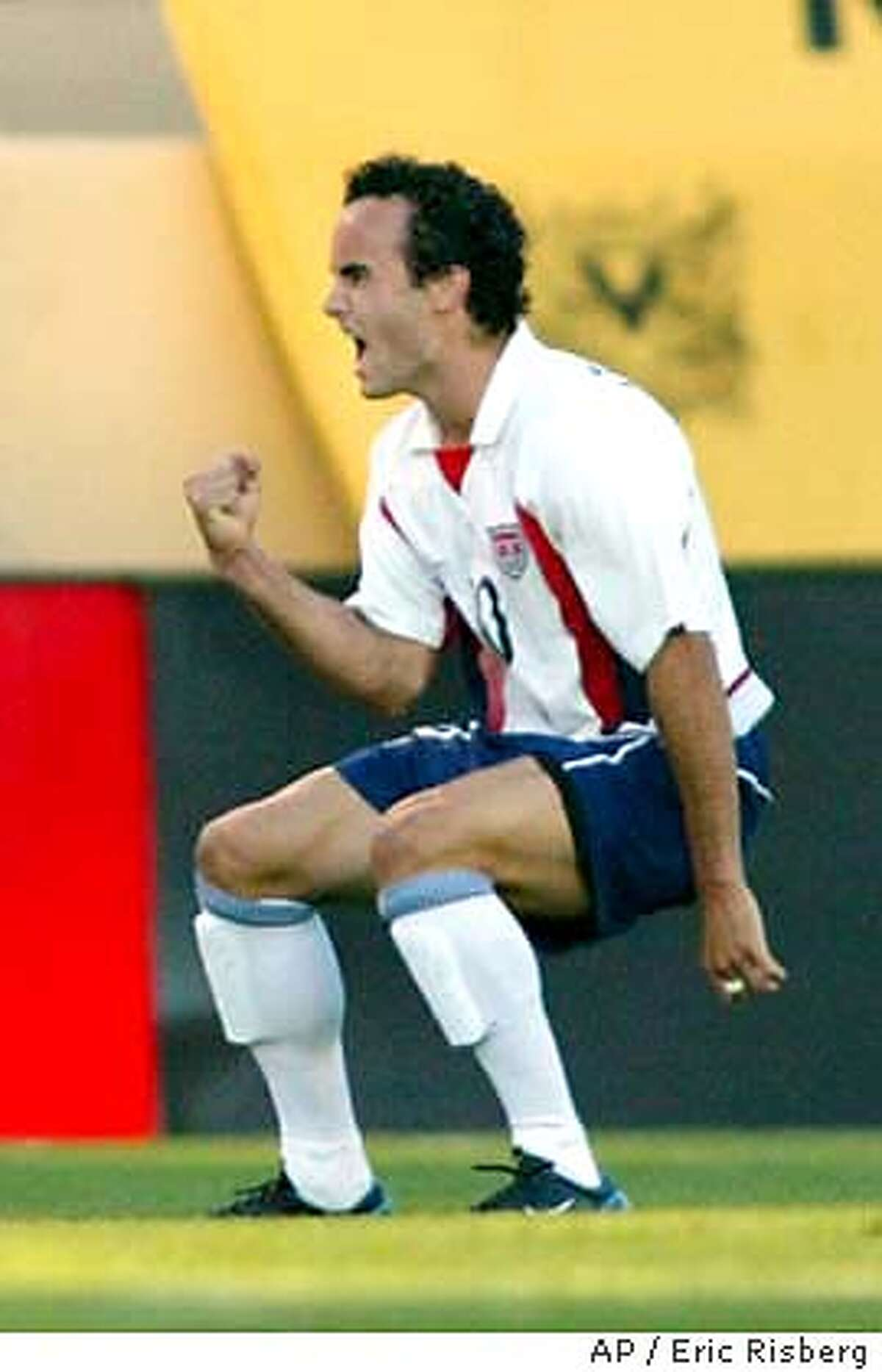 U.S. team forward Landon Donovan celebrates after scoring a penalty kick against Wales during the first half of their friendly match in San Jose, Calif., Monday May 26, 2003.(AP Photo/Eric Risberg) CAT