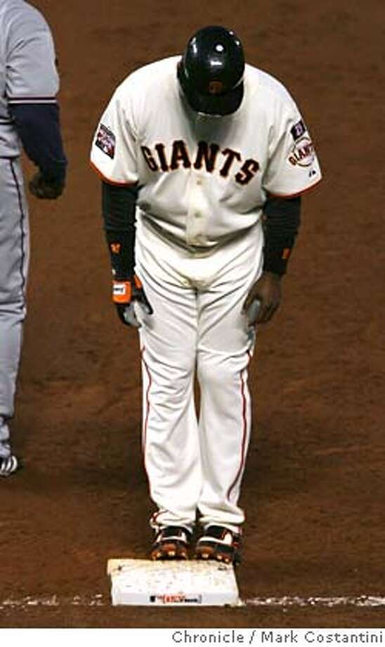Barry Bonds stands and stares at first base after being walked in the 3rd inning.  Giants v. Nationals at ATT Park.  Photo: Mark Costantini / S.F. Chronicle Ran on: 08-07-2007  Barry Bonds is a bit downcast after being walked in the third inning, on his way to an 0-for-3 night. Photo: Mark Costantini
