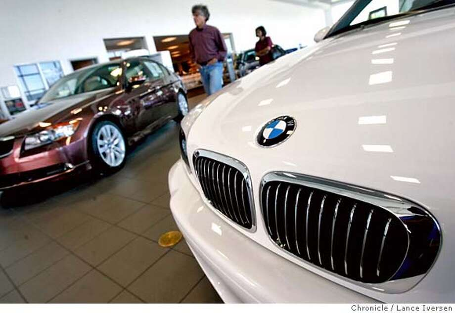 AUTOROW_55053.JPG  Prospective customers stroll through the showroom passing a White M-3 BMW two-door convertible with a sticker price of $62,000. Berkeley's about to make some zoning changes to allow its 5 auto dealers to expand including Weatherford BMW one of Berkeley's most successful dealership. But it may be too little too late - Oakland plans to build a huge auto mall on the old army base to lure them all away, costing Berkeley millions in sales tax revenue. (AUG3) Lance Iversen/The Chronicle (cq) SUBJECT 8/3/07,in BERKELEY. CA. MANDATORY CREDIT PHOTOG AND SAN FRANCISCO CHRONICLE/NO SALES MAGS OUT Photo: By Lance Iversen